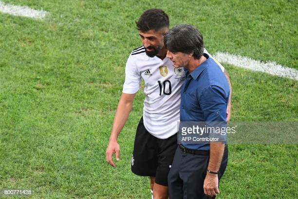 Germany's coach Joachim Loew speaks to Germany's midfielder Kerem Demirbay at the end of the 2017 FIFA Confederations Cup group B football match...