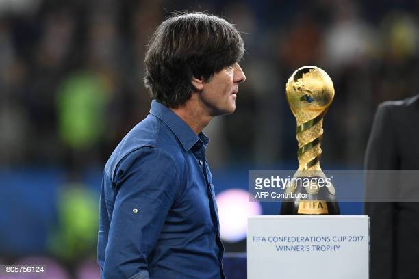 Germany's coach Joachim Loew walks past the winner's trophy during the award ceremony after Germany beat Chile 10 in the 2017 Confederations Cup...