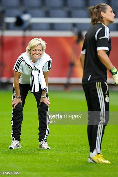 Germany's coach Siliva Neid and Germany's goalkeeper Nadine Anderer take part in the training session of the German team at the Friend's Arena in...