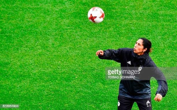 Germany's coach Steffi Jones controls a ball during a training at the Sparta Rotterdam Stadium during the UEFA Women's Euro 2017 football tournament...