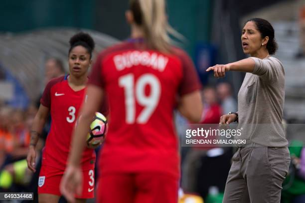 Germany's coach Steffi Jones yells while England's defender Demi Stokes waits to throw the ball in during the She Believes Cup at RFK Stadium March 7...