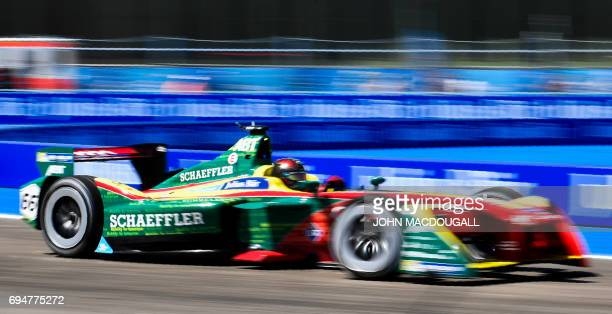 Germany's Daniel Abt with Audi Sport negotiates a bend during the qualifying round of the Berlin leg of the Formula E electric car Championships on...