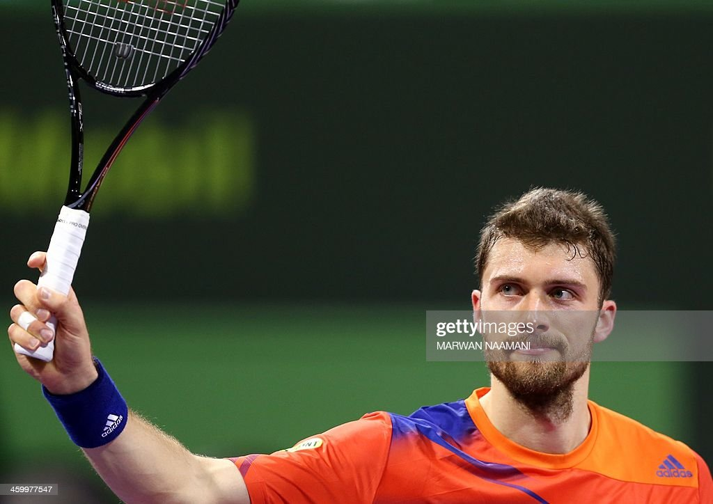 Germany's Daniel Brands salutes crowds after beating Spain's David Ferrer during their tennis match in Qatar's ExxonMobil Open in Doha on January 01, 2014.