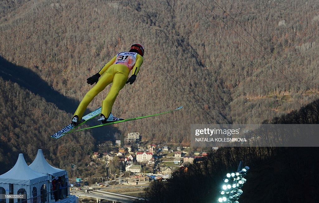 Germany's Danny Queck jumps during the men's normal hill individual at the FIS Ski Jumping World Cup tournament in Sochi on December 9, 2012.
