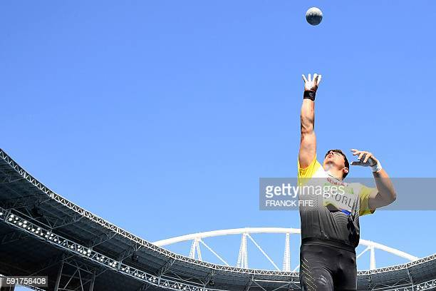 TOPSHOT Germany's David Storl competes in the Men's Shot Put Qualifying Round during the athletics event at the Rio 2016 Olympic Games at the Olympic...