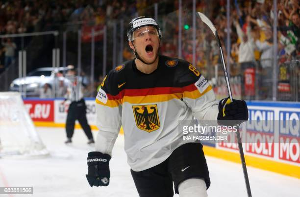 Germany's David Wolf celebrates scoring during the IIHF Men's World Championship Ice Hockey match between Germany and Latvia in Cologne western...