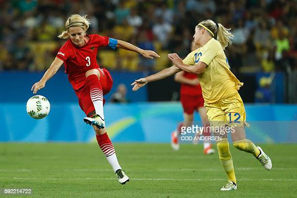 Germany's defender and captain Saskia Bartusiak and Sweden's striker Olivia Schough vie for the ball during the Rio 2016 Olympic Games women's...