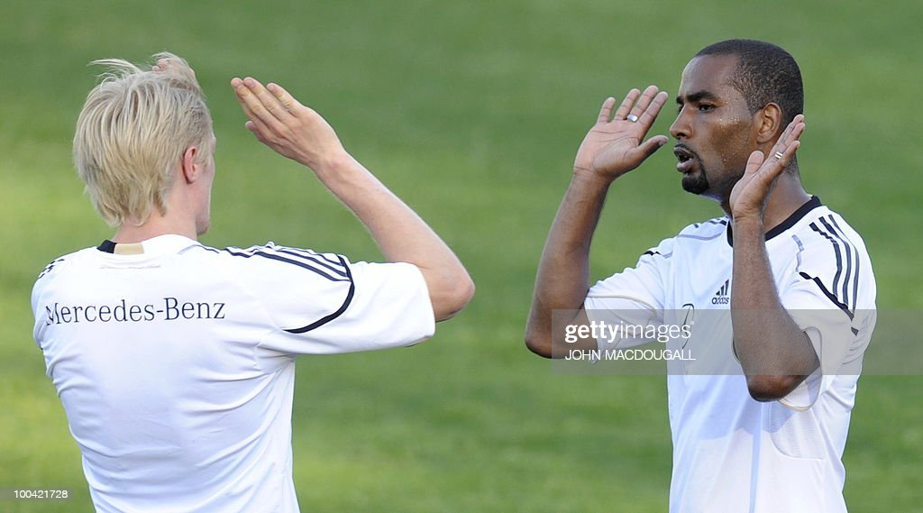 Germany's defender Andreas Beck (L) congratulates Germany's striker Cacau after he scored during a training match Germany vs Sued Tyrol FC at the team's training centre in Appiano, near the north Italian city of Bolzano May 24, 2010. The German football team is currently taking part in a 12-day training camp in Appiano to prepare for the upcoming FIFA Football World Cup in South Africa.