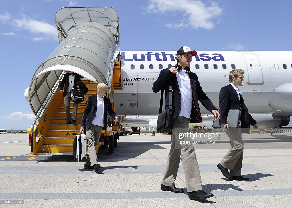 Germany's defender Andreas Beck, Germany's midfielder Mesut Oezil, and Germany's midfielder Marko Marin get off the plane in Verona May 21, 2010, as the German team arrives for a 12-day long training camp near Bolzano to prepare for the upcoming FIFA Football World Cup in South Africa.