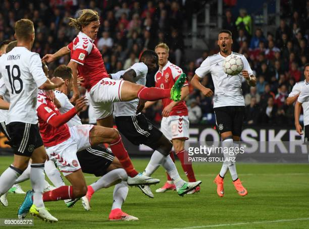 Germany's defender Antonio Ruediger and Denmark´s Jannik Vestergaard vie for the ball during the friendly football match between Denmark and Germany...