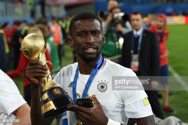 Germany's defender Antonio Ruediger holds the trophy after beating Chile 10 to win the 2017 Confederations Cup final football match between Chile and...