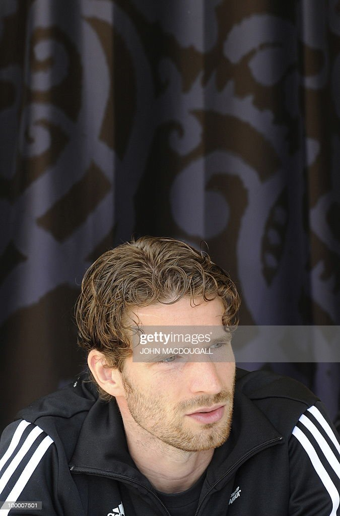 Germany's defender Arne Friedrich speaks to a journalist during a so-called media day at the Verdura Golf and Spa resort, near Sciacca May 19, 2010. The German team is currently taking part in a 'Regeneration' camp in Sicily to prepare for the upcoming FIFA Football World Cup in South Africa.