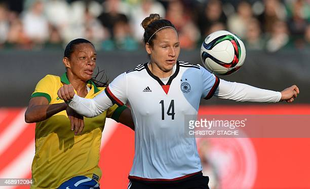 Germany's defender Babett Peter and Brazil's midfielder Rosana vie for the ball during the friendly women football match between Germany and Brazil...
