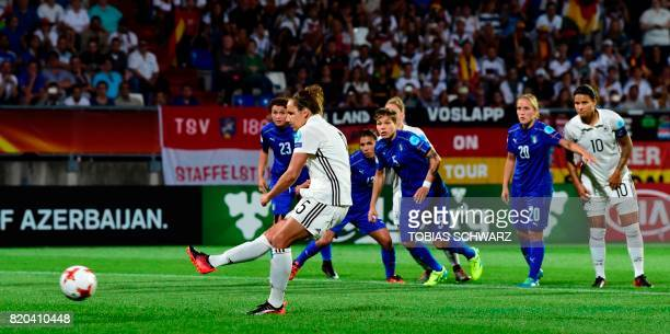 Germany's defender Babett Peter scores a goal during the UEFA Women's Euro 2017 football tournament between Germany and Italy at Stadium Koning...