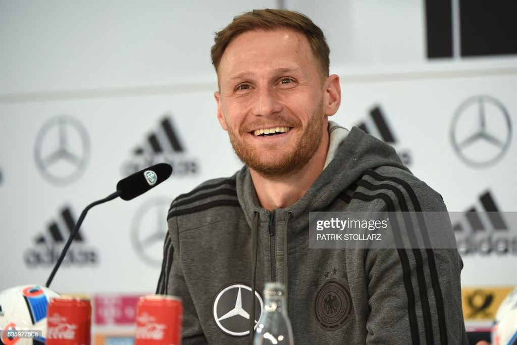Germany's defender Benedikt Hoewedes gives a press conference on the sideline of the team's preparation for the upcoming Euro 2016 European football championships on May 31, 2016 in Ascona. / AFP / PATRIK