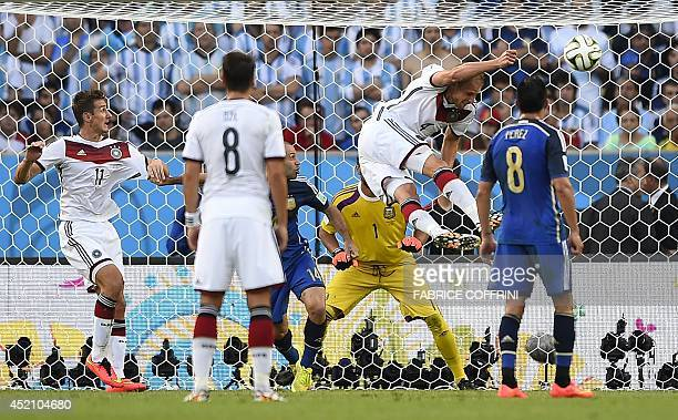 Germany's defender Benedikt Hoewedes heads the ball during the final football match between Germany and Argentina for the FIFA World Cup at The...