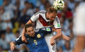 Germany's defender Benedikt Hoewedes vies with Argentina's forward Gonzalo Higuain during the final football match between Germany and Argentina for...