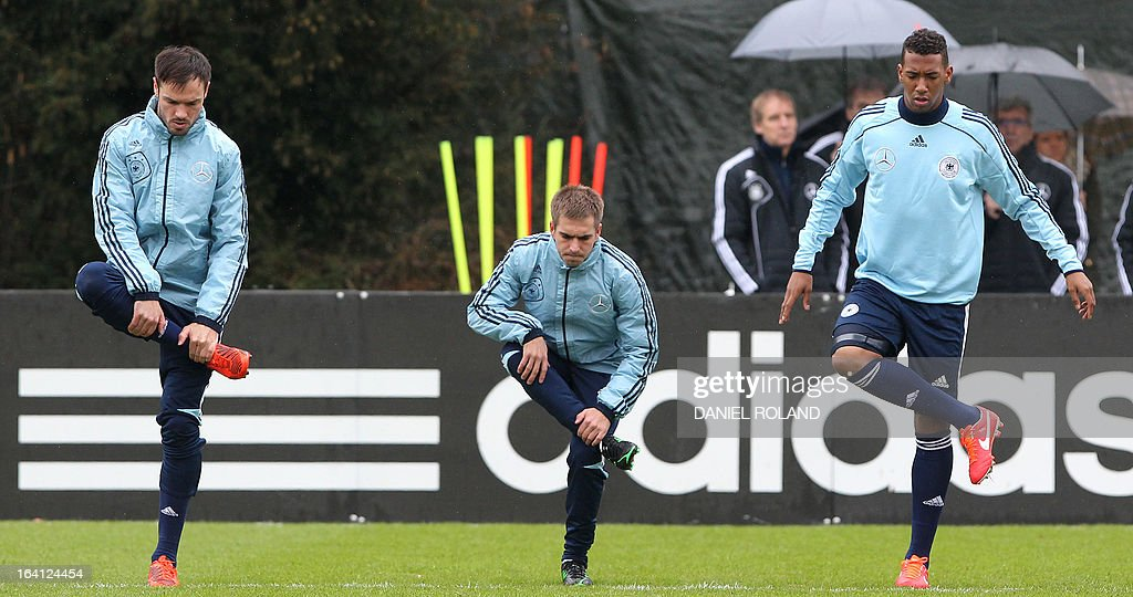 Germany's defender Heiko Westermann, Germany's defender Philipp Lahm and Germany's defender Jerome Boateng attend a training session of the German national football team prior to the World Cup qualifier against Kazakhstan in Frankfurt, Germany, on March 20, 2013.