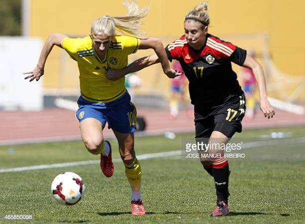 Germany's defender Jennifer Cramer vies with Sweden's forward Sofia Jakobsson during the Algarve Cup semifinal football match Sweden vs Germany at...