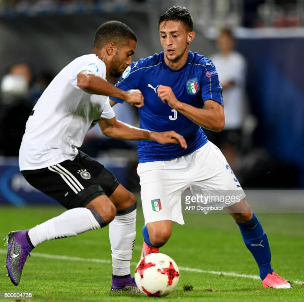 CORRECTION Germany's defender Jeremy Toljan and Italy's Antonio Barreca vie for the ball during the UEFA U21 European Championship Group C football...