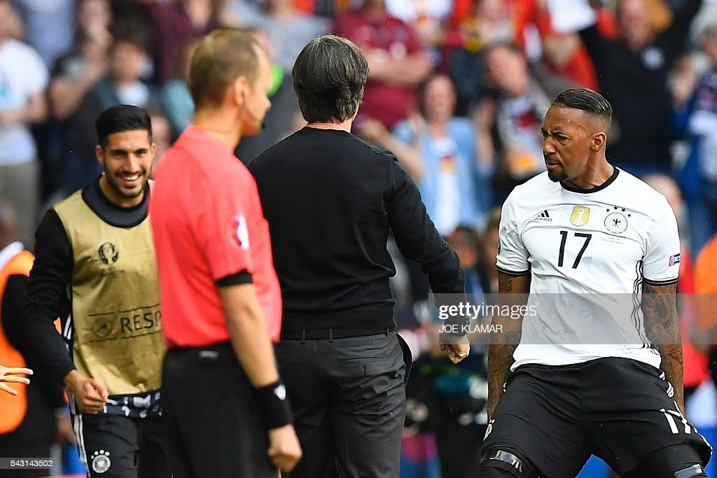 Germany's defender Jerome Boateng (R) celebrates with Germany's coach Joachim Loew after scoring a goal during the Euro 2016 round of 16 football match between Germany and Slovakia at the Pierre-Mauroy stadium in Villeneuve-d'Ascq near Lille on June 26, 2016. / AFP / Joe KLAMAR