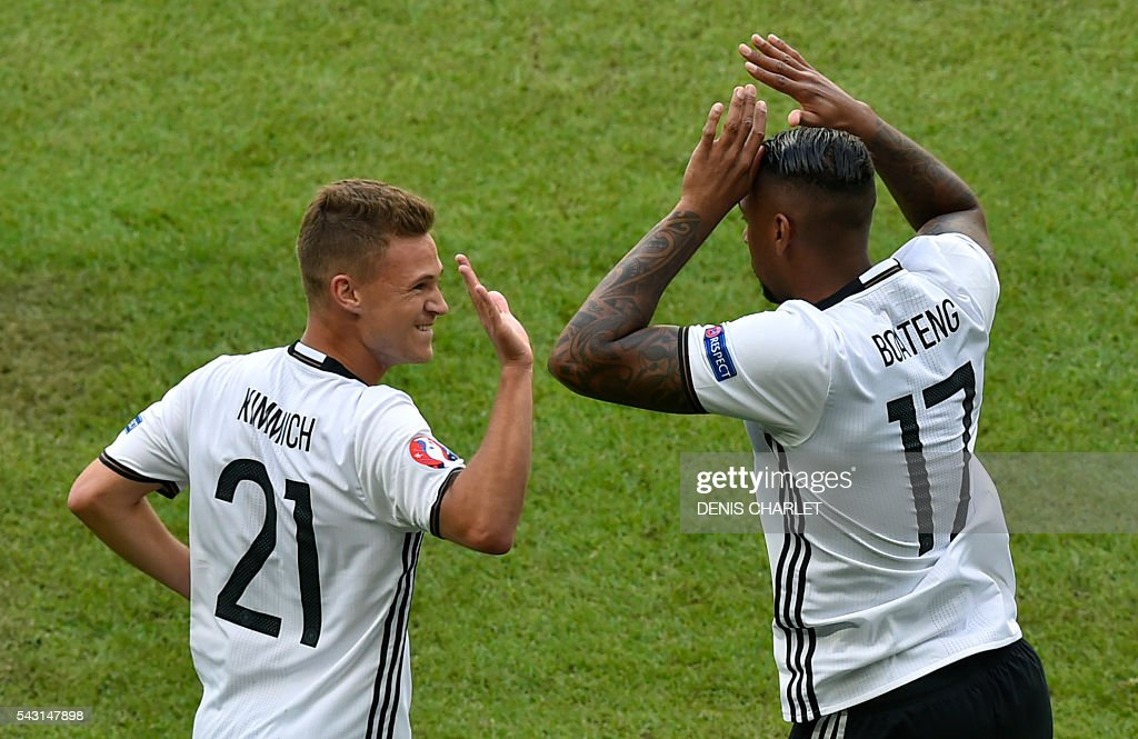 Germany's defender Jerome Boateng (R) celebrates with Germany's midfielder Joshua Kimmich after scoring during the Euro 2016 round of 16 football match between Germany and Slovakia at the Pierre-Mauroy stadium in Villeneuve-d'Ascq, near Lille, on June 26, 2016. / AFP / DENIS