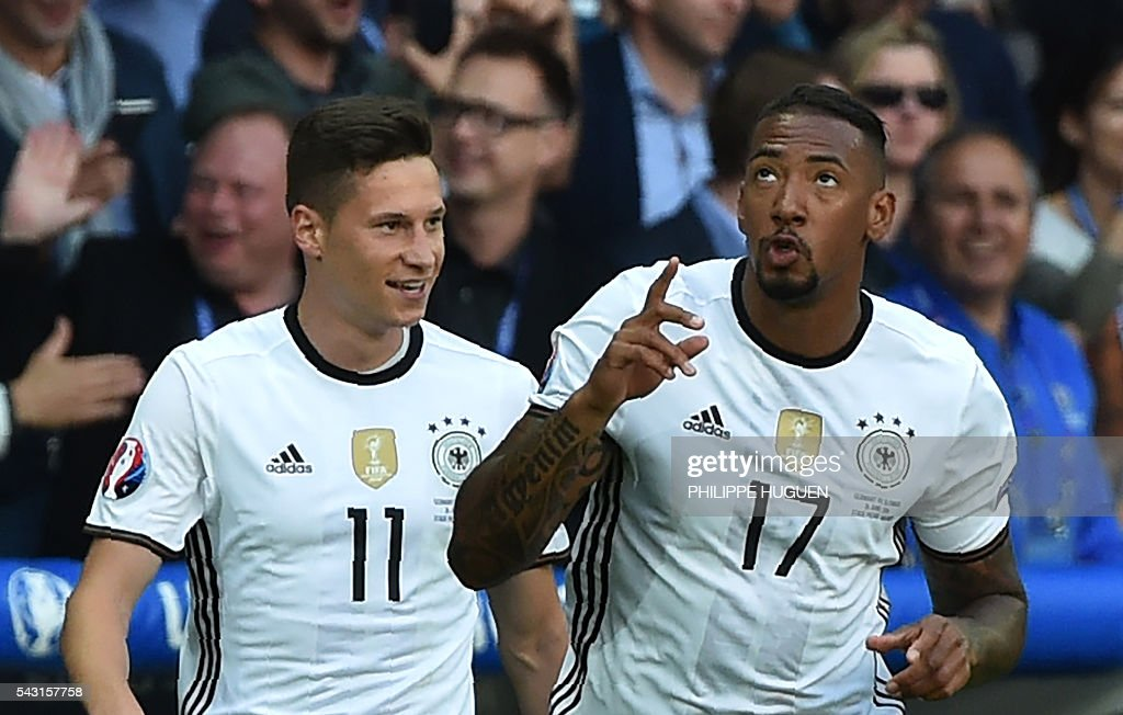 Germany's defender Jerome Boateng (R) celebrates with Germany's midfielder Julian Draxler after scoring during the Euro 2016 round of 16 football match between Germany and Slovakia at the Pierre-Mauroy stadium in Villeneuve-d'Ascq, near Lille, on June 26, 2016. / AFP / PHILIPPE