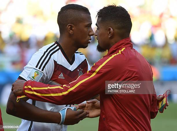 Germany's defender Jerome Boateng embraces his brother Ghana's forward KevinPrince Boateng prior to a Group G football match between Germany and...