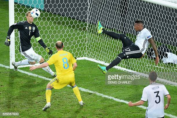 TOPSHOT Germany's defender Jerome Boateng kicks the ball from his goal line during the Euro 2016 group C football match between Germany and Ukraine...