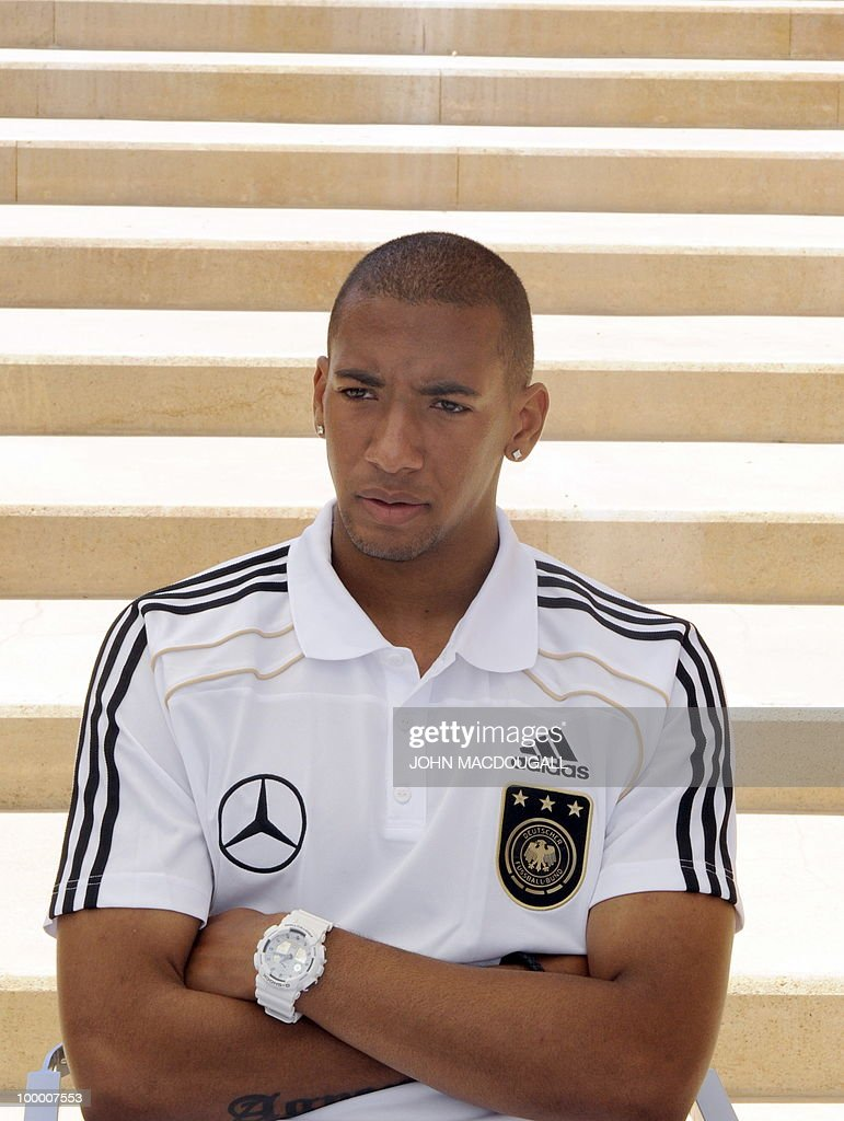 Germany's defender Jerome Boateng speaks to a journalist during a so-called media day at the Verdura Golf and Spa resort, near Sciacca May 19, 2010. The German team is currently taking part in a 'Regeneration' camp in Sicily to prepare for the upcoming FIFA Football World Cup in South Africa.