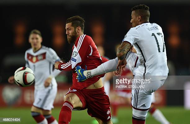 Germany's defender Jerome Boateng vies for the ball with Georgia´s Levan Mchedlidze during the Euro 2016 qualifying football match between Georgia...