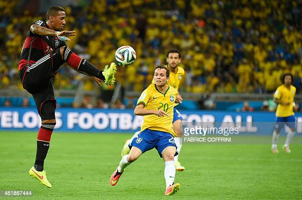 Germany's defender Jerome Boateng vies with Brazil's forward Bernard during the semifinal football match between Brazil and Germany at The Mineirao...