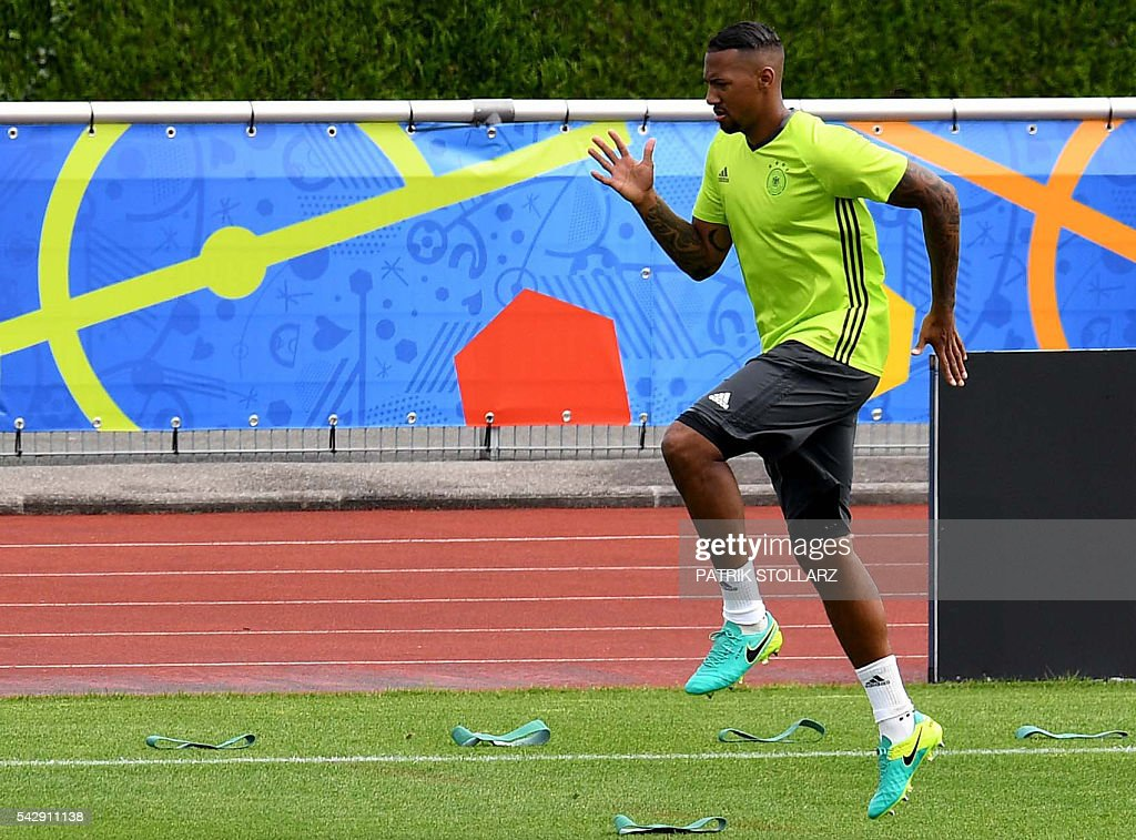 Germany's defender Jerome Boateng warms up during a training session of Germany's national football team at the team's training ground in Evian-les-Bains, south-eastern France, on June 25, 2016, on the eve of the Euro 2016 round of sixteen football match between Germany and Slovakia. / AFP / PATRIK