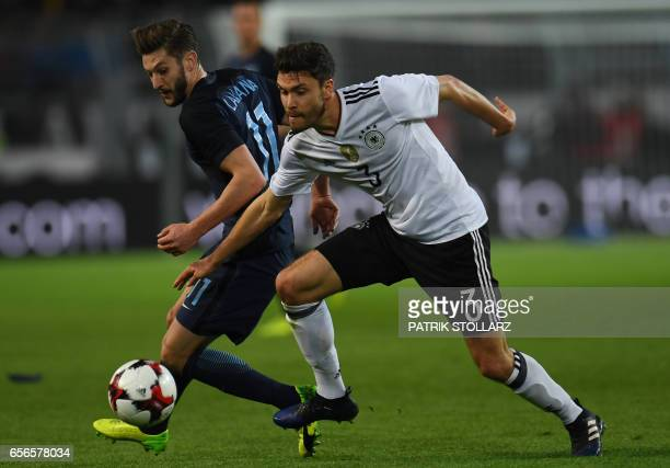 Germany's defender Jonas Hector and England´s Adam Lallana during a friendly football match between Germany and England on March 22 2017 in Dortmund...