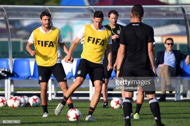 Germany's defender Jonas Hector and Germany's midfielder Julian Draxler attend a training session in Sochi on June 28 2017 on the eve of the Russia...