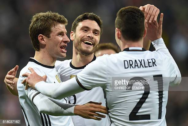 Germany's defender Jonas Hector celebrates scoring the 30 his first goal for Germany with Germany's midfielder Thomas Mueller and Germany's...