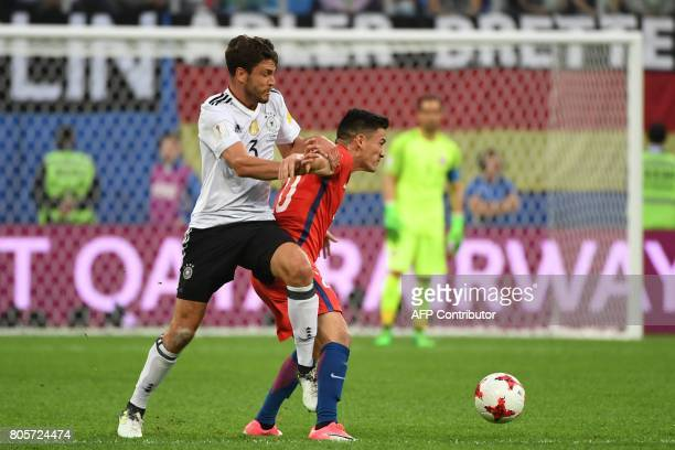 Germany's defender Jonas Hector vies for the ball against Chile's midfielder Charles Aranguiz during the 2017 Confederations Cup final football match...