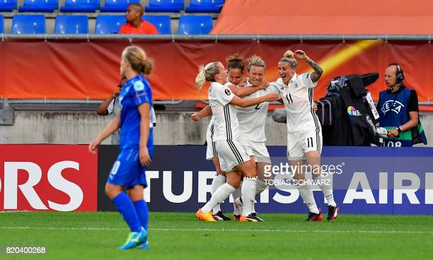 Germany's defender Josephine Henning celebrates with teammates after scoring during the UEFA Women's Euro 2017 football match between Germany and...