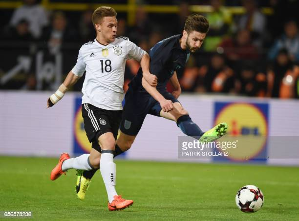 Germany's defender Joshua Kimmich and England´s Adam Lallana vie during a friendly football match between Germany and England on March 22 2017 in...