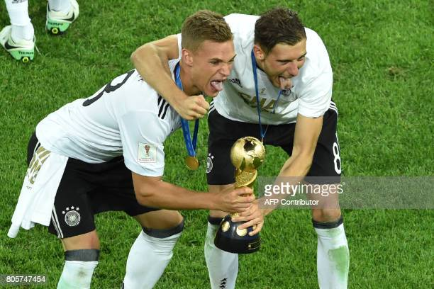 Germany's defender Joshua Kimmich and Germany's midfielder Leon Goretzka pose with the trophy after winning the 2017 Confederations Cup final...