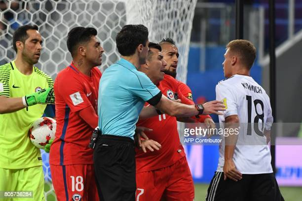 Germany's defender Joshua Kimmich argues with Chile's midfielder Arturo Vidal during the 2017 Confederations Cup final football match between Chile...