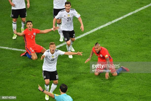 Germany's defender Joshua Kimmich argues with Serbian referee Milorad Mazic as Chile's forward Alexis Sanchez and Chile's midfielder Arturo Vidal...