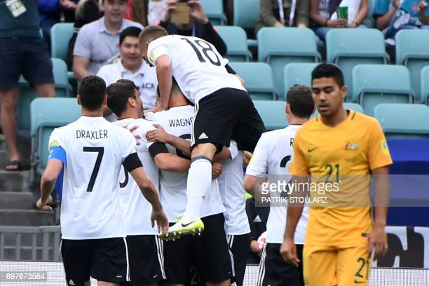 Germany's defender Joshua Kimmich celebrates with team mates a goal by Germany's midfielder Lars Stindl during the 2017 Confederations Cup group B...