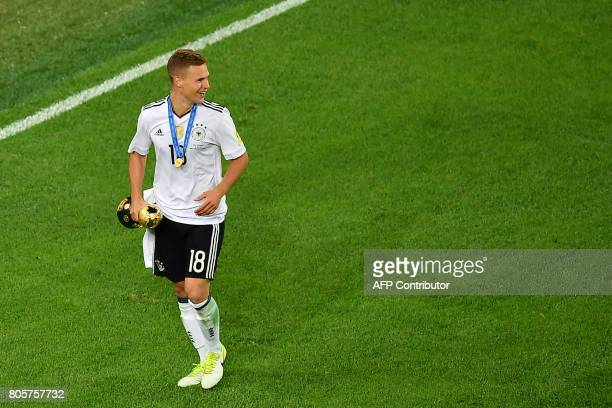 Germany's defender Joshua Kimmich celebrates with the trophy after winning the 2017 Confederations Cup final football match between Chile and Germany...