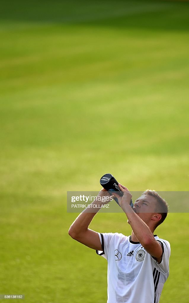 Germany's defender Joshua Kimmich drinks water out of a bottle during a training session on May 31, 2016 in Ascona as part of the team's preparation for the upcoming Euro 2016 European football championships. / AFP / PATRIK