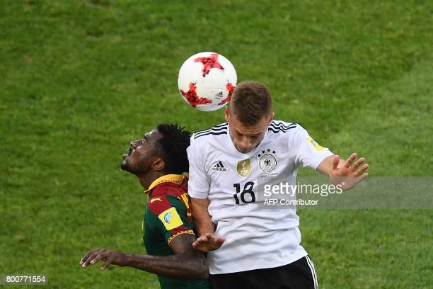 Germany's defender Joshua Kimmich heads the ball with Cameroon's midfielder Andre Zambo during the 2017 FIFA Confederations Cup group B football...