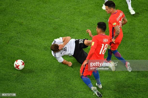 Germany's defender Joshua Kimmich holds his head in front of Chile's defender Gonzalo Jara and Chile's midfielder Charles Aranguiz during the 2017...