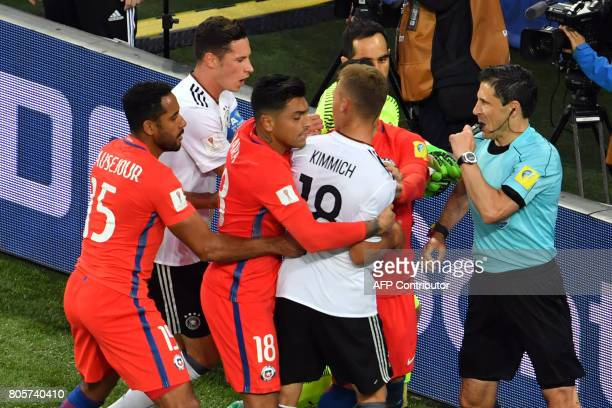 Germany's defender Joshua Kimmich is held back as he argues with Chile's midfielder Arturo Vidal during the 2017 Confederations Cup final football...