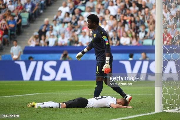 Germany's defender Joshua Kimmich reacts next to Cameroon's goalkeeper Joseph Ondoa after missing a chance to score during the 2017 FIFA...