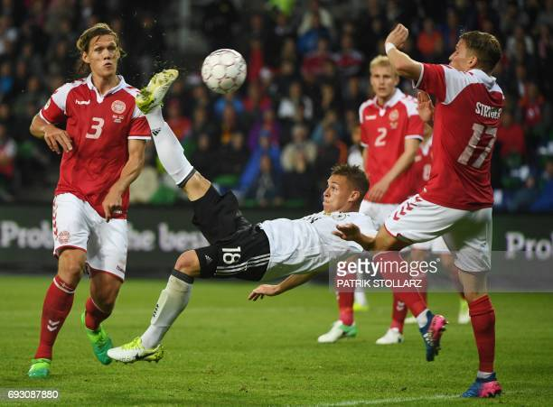 Germany's defender Joshua Kimmich scores past Denmark´s Jannik Vestergaard and Jens Stryger Larsen during the friendly football match between Denmark...